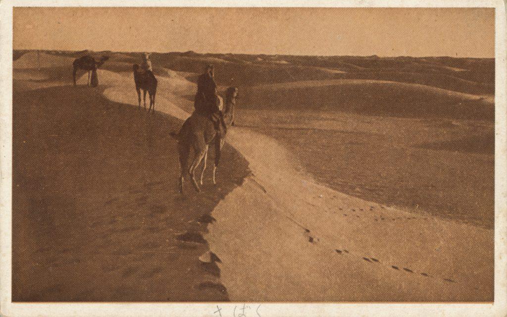 砂漠とラクダに乗った男性たち(Desert,The men who took camels)